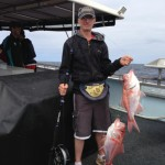 Rhys Cooper with a double header of Red Snapper