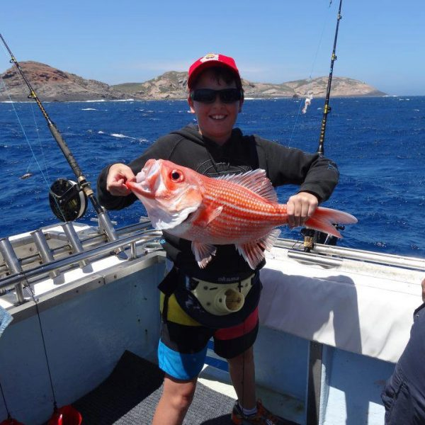 Frazer Childs with a Red Snapper he caught out fishing with us on 30/12/12